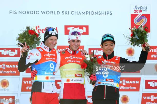 Silver medalist Bernhard Gruber of Austria Gold medalist Jarl Magnus Riiber of Norway and bronze medalist Akito Watabe of Japan celebrate on the...