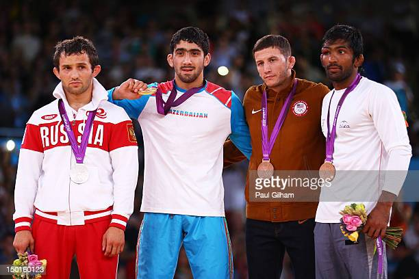 Silver medalist Besik Kudukhov of Russia Gold medalist Toghrul Asgarov of Azerbaijan Bronze medalist Coleman Scott of the United States and Bronze...