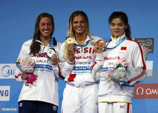 Silver medalist Bethany Galat of the United States gold medalist Yuliya Efimova of Russia and bronze medalist Jinglin Shi of China pose with the...