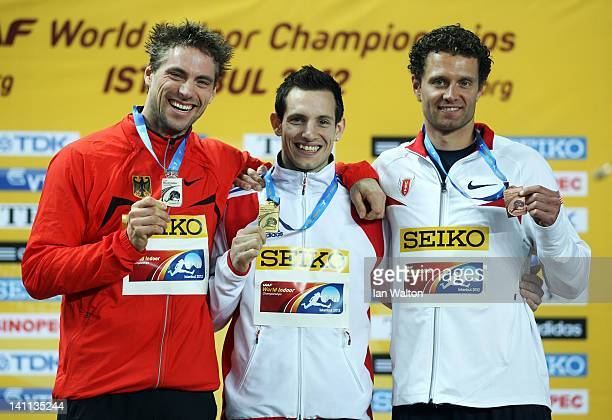 Silver medalist Bjorn Otto of Germany gold medalist Renaud Lavillenie of France and bronze medalist Brad Walker of the United States stand on the...