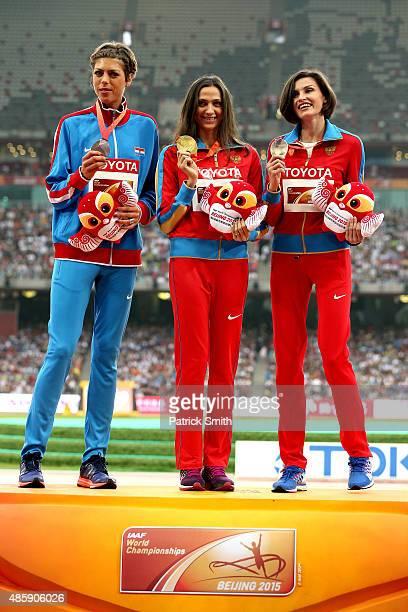 Silver medalist Blanka Vlasic of Croatia gold medalist Maria Kuchina of Russia and bronze medalist Anna Chicherova of Russia pose on the podium...