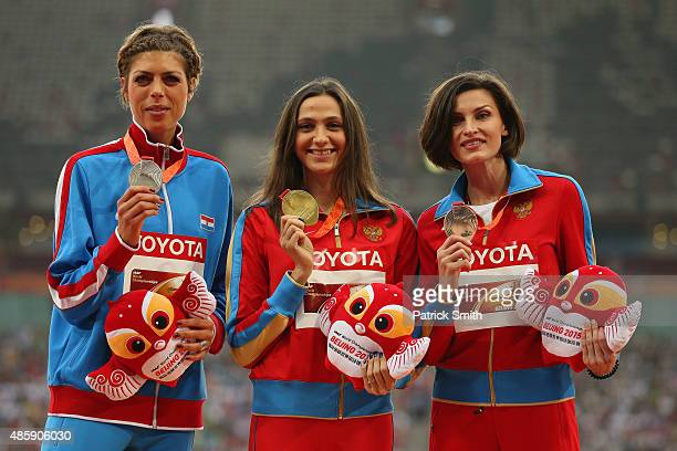 Silver medalist Blanka Vlasic of Croatia gold medalist Maria Kuchina of Russia and bronze medalist Anna Chicherova of Russia pose on the podium...
