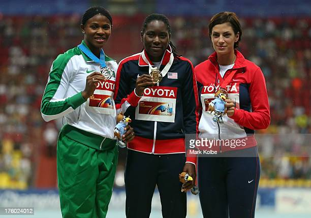 Silver medalist Blessing Okagbare of Nigeria gold medalist Brittney Reese of the United States and bronze medalist Ivana Spanovic of Serbia stand on...