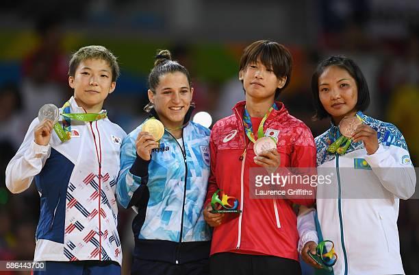 Silver medalist Bokyeong Jeong of Korea, gold medalist Paula Pareto of Argentina, bronze medalist Ami Kondo of Japan and bronze medalist Otgontsetseg...