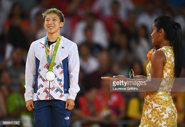 Silver medalist Bokyeong Jeong of Korea smiles on the podium after the Women's 48 kg Judo competition on Day 1 of the Rio 2016 Olympic Games at...
