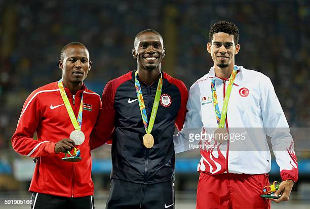 Silver medalist Boniface Mucheru Tumuti of Kenya gold medalist Kerron Clement of the United States and bronze medalist Yasmani Copello of Turkey pose...