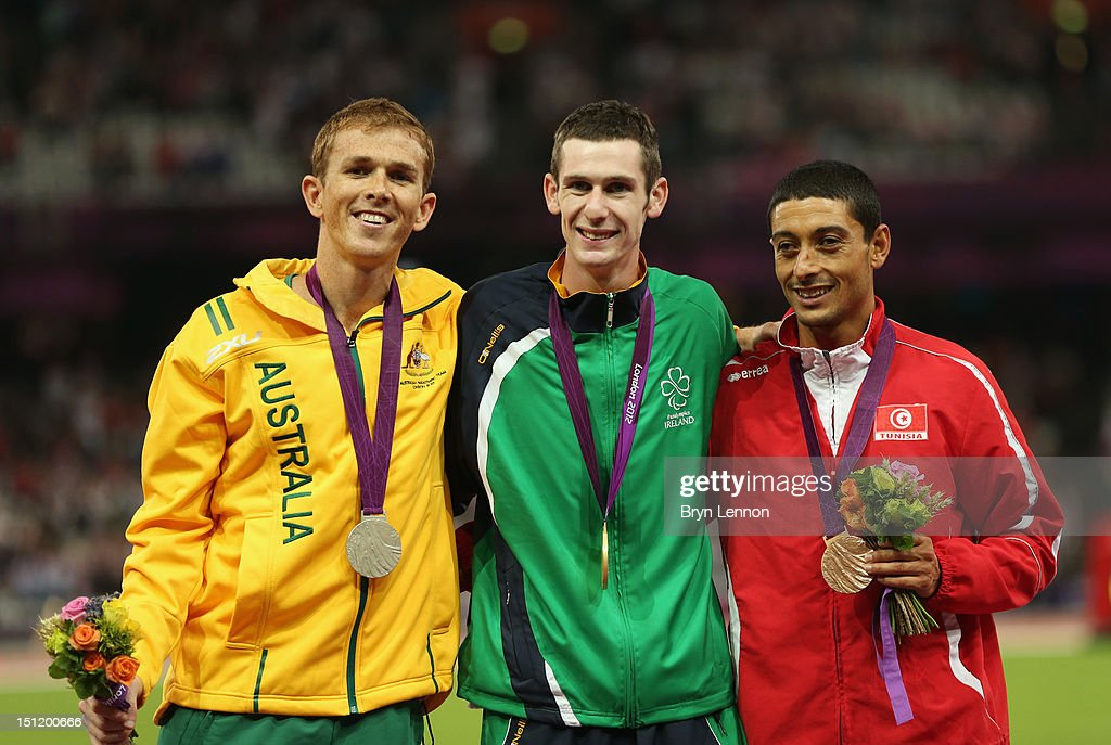 Silver medalist Brad Scott of Australia, Gold medalist Michael Mckillop of Ireland and bronze medalist Mohamed Charmi of Tunisia pose on the podium during the medal ceremony for the Men's 1500m - T37 Final on day 5 of the London 2012 Paralympic Games at Olympic Stadium on September 3, 2012 in London, England.