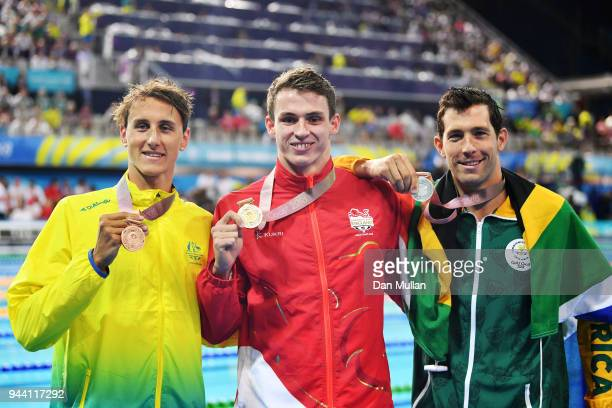 Silver medalist Bradley Tandy of South Africa gold medalist Benjamin Proud of England and bronze medalist Cameron McEvoy of Australia pose during the...