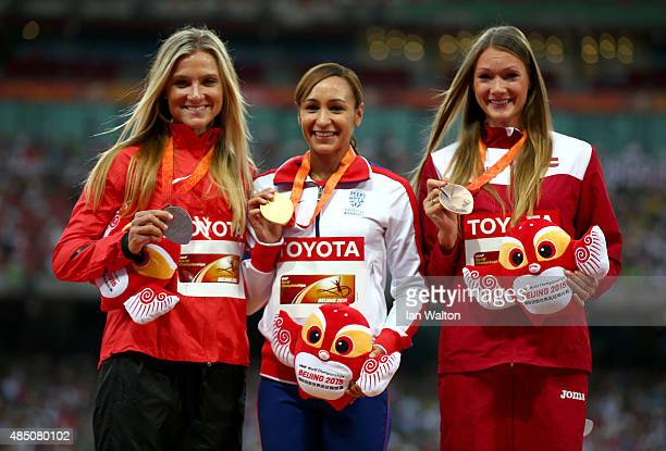 Silver medalist Brianne Theisen Eaton of Canada, gold medalist Jessica Ennis-Hill of Great Britain and bronze medalist Laura Ikauniece-Admidina of...