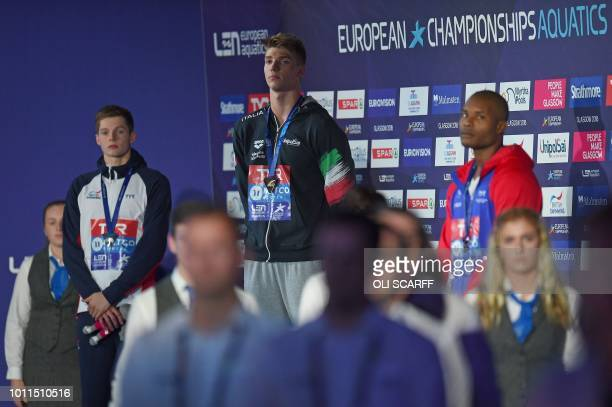 Silver medalist Britain's Duncan Scott Gold medalist Italy's Alessandro Miressi and Bronze medalist France's Mehdy Metella pose on the podium during...