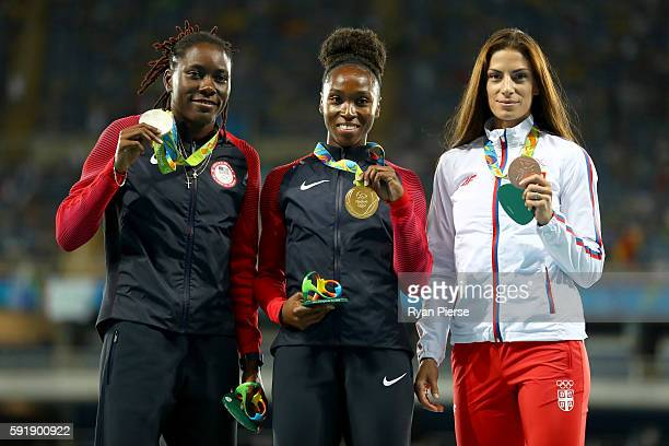 Silver medalist Brittney Reese of the United States gold medalist Tianna Bartoletta of the United States and bronze medalist Ivana Spanovic of Serbia...