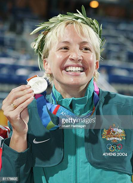 Silver medalist Brooke Hanson of Australia poses with her medal after the medal ceremony for the women's swimming 100 metre breaststroke event on...