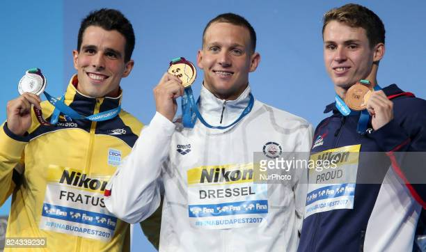 Silver medalist Bruno Fratus of Brazil gold medalist Caeleb Remel Dressel of the United States and bronze medalist Benjamin Proud of Great Britain...