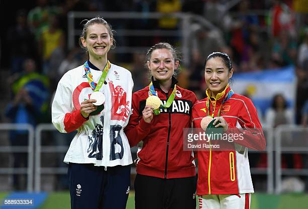 Silver medalist Bryony Page of Great Britain, gold medalist Rosannagh Maclennan of Canada and bronze medalist Dan Li of China pose during the medal...
