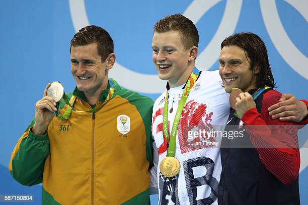 Silver medalist Cameron van der Burgh gold medalist Adam Peaty of Great Britain and Cody Miller of the United States pose on the podium during the...