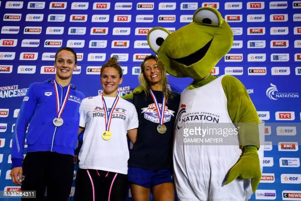 Silver medalist Camille Dauba gold medalist Fanny Deberghes and bronze medalist Fantine Lesaffre pose with mascott Raoul on the podium of the women's...
