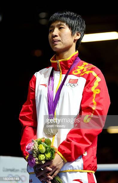 Silver medalist Cancan Ren of China celebrates on the podium during the medal ceremony for the Women's Fly Boxing final bout on Day 13 of the London...