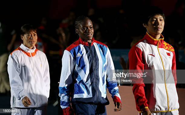 Silver medalist Cancan Ren of China gold medalist Nicola Adams of Great Britain and bronze medalist Chungneijang Mery Kom Hmangte of India walk to...