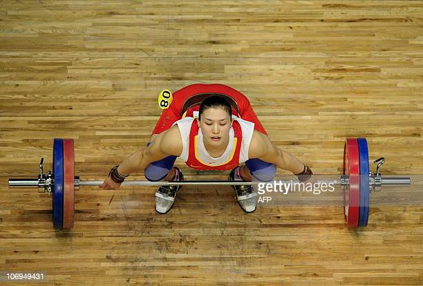Silver medalist Cao Lei of China competes in the women's 75kg weightlifting contest at the 16th Asian Games in Guangzhou on November 18 2010...