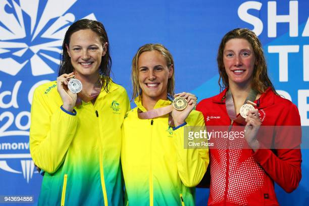 Silver medalist Cate Campbell of Australia gold medalist Bronte Campbell of Australia and bronze medalist Taylor Ruck of Canada pose during the medal...