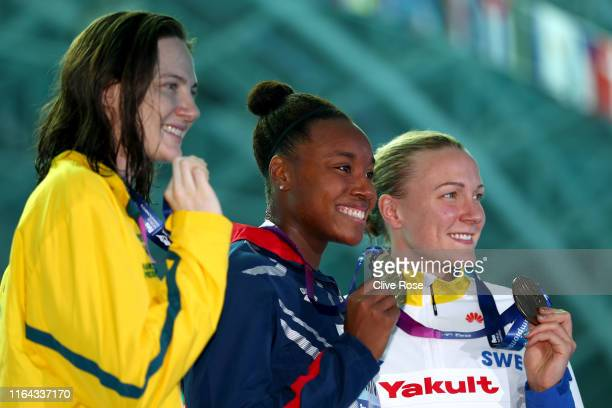 Silver medalist Cate Campbell of Australia, gold medalist Simone Manuel of the United States and bronze medalist Sarah Sjostrom of Sweden pose during...