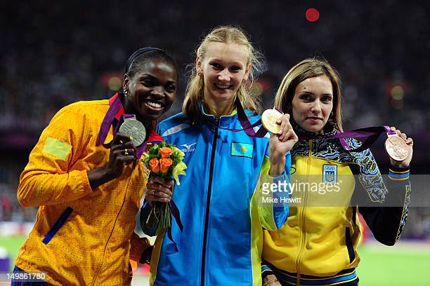 Silver medalist Caterine Ibarguen of Colombia gold medalist Olga Rypakova of Kazakhstan and bronze medalist Olha Saladuha of Ukraine pose on the...