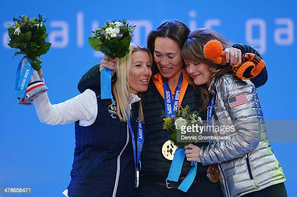 Silver medalist Cecile Hernandez Cervellon of France gold medalist Bibian MentelSpee of Netherlands and bronze medalist Amy Purdy of the United...