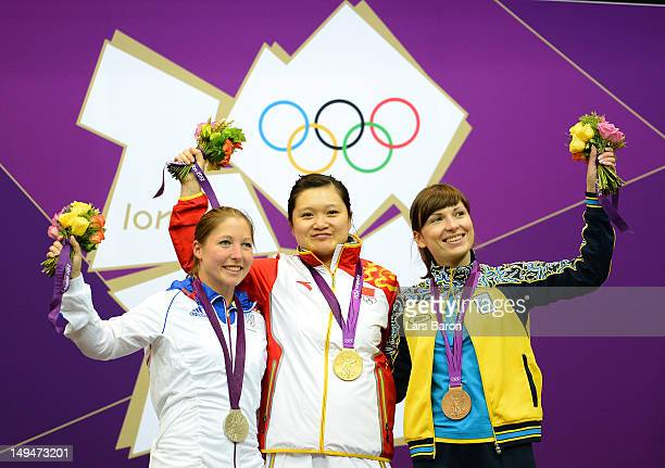 Silver medalist Celine Goberville of France gold medalist Wenjun Guo of China and bronze medalist Olena Kostevych of Ukraine pose on the podium...