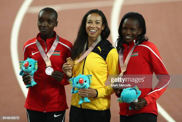 Silver medalist Celliphine Chepteek Chespol of Kenya gold medalist Aisha Praught of Jamaica and bronze medalist Purity Cherotich Kirui of Kenya pose...
