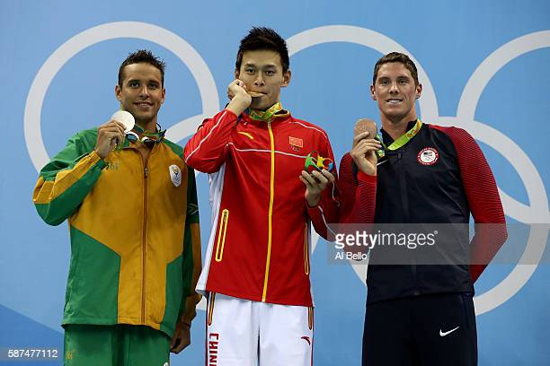 Silver medalist Chad le Clos of South Africa gold medalist Yang Sun of China and bronze medalist Conor Dwyer of the United States poses on the podium...