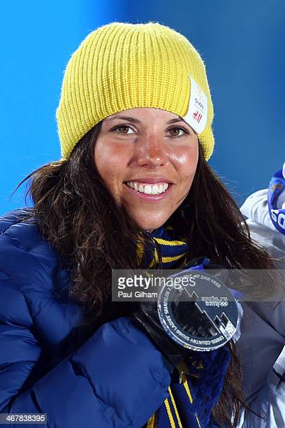 Silver medalist Charlotte Kalla of Sweden celebates on the podium during the medal ceremony for the for the for the Women's Skiathlon 7.5km Classic &...