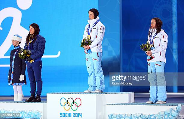 Silver medalist Charlotte Kalla of Sweden gold medalist Marit Bjoergen of Norway and bronze medalist Heidi Weng of Norway on the podium during the...