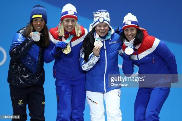 Silver medalist Charlotte Kalla of Sweden gold medalist Ragnhild Haga of Norway and bronze medalists Krista Parmakoski of Finland and Marit Bjoergen...