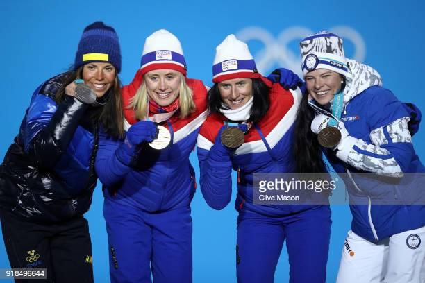Silver medalist Charlotte Kalla of Sweden gold medalist Ragnhild Haga of Norway and bronze medalists Marit Bjoergen of Norway and Krista Parmakoski...