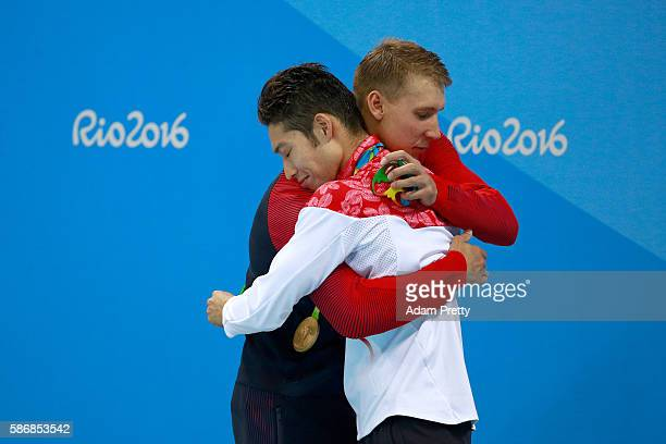 Silver medalist Chase Kalisz of the United States and gold medal medalist Kosuke Hagino of Japan embrace during the medal ceremony for the Final of...