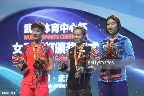 Silver medalist Chen Yufei of China and gold medalist Tai Tzu Ying of Chinese Taipei pose on the podium during women's singles final match on day six...