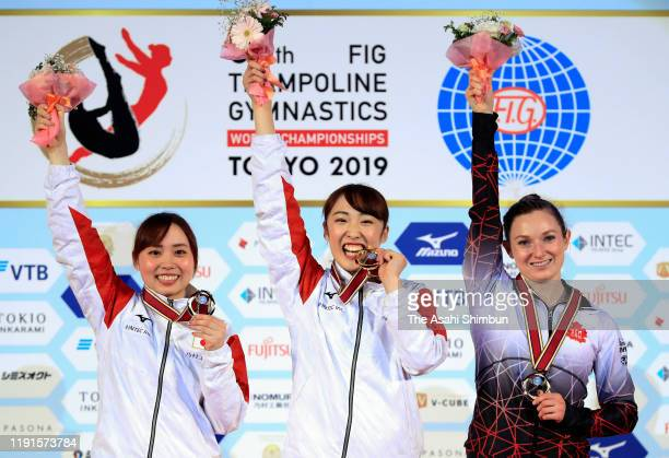 Silver medalist Chisato Doihata of Japan gold medalist Hikaru Mori of Japan and bronze medalist Rosie MacLennan of Canada celebrate on the podium at...