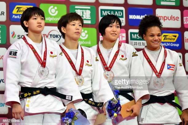Silver medalist Chizuru Arai gold medalist Yoko Ono of Japan bronze medallists Shiho Tanaka of Japan and Maria Perez of Puerto Rico pose on the...