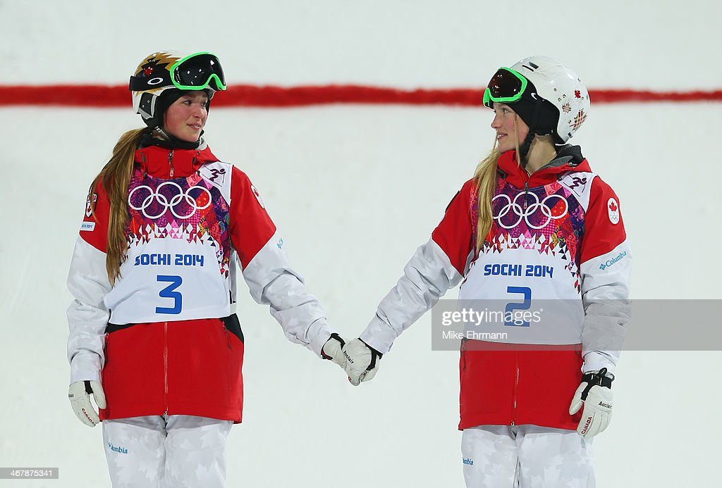 Silver medalist Chloe Dufour-Lapointe of Canada and gold medalist Justine Dufour-Lapointe of Canada congratulate each other during the flower ceremony following the Ladies' Moguls Final 3 on day one of the Sochi 2014 Winter Olympics at Rosa Khutor Extreme Park on February 8, 2014 in Sochi, Russia.