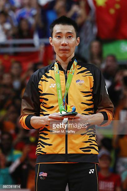 Silver medalist Chong Wei Lee of Malaysia poses on the podium during the medal ceremony for the Men's Singles Badminton on Day 15 of the Rio 2016...