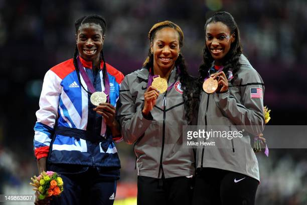 Silver medalist Christine Ohuruogu of Great Britain gold medalist Sanya RichardsRoss of the United States and bronze medalist DeeDee Trotter of the...