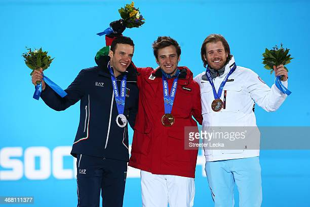 Silver medalist Christof Innerhofer of Austria gold medalist Matthias Mayer of Austria and bronze medallist Kjetil Jansrud of Norway celebrate on the...