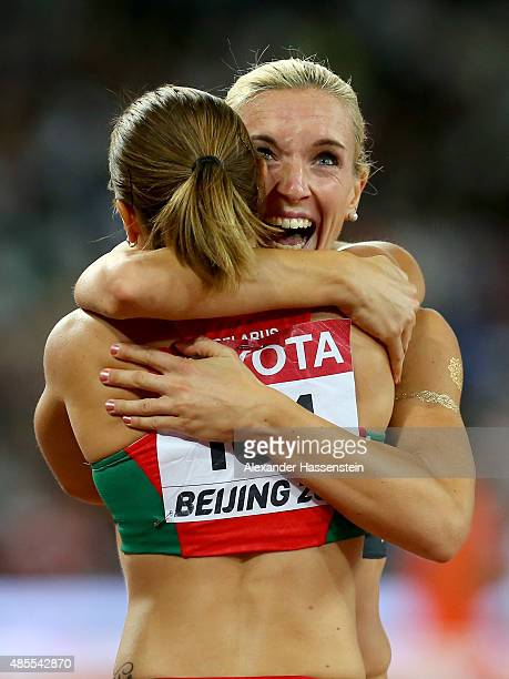 Silver medalist Cindy Roleder of German embraces bronze medalist Alina Talay of Belarus after the Women's 100 metres hurdles final during day seven...
