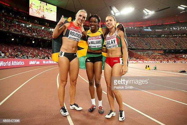 Silver medalist Cindy Roleder of Germany gold medalist Danielle Williams of Jamaica and bronze medalist Alina Talay of Belarus celebrate after the...