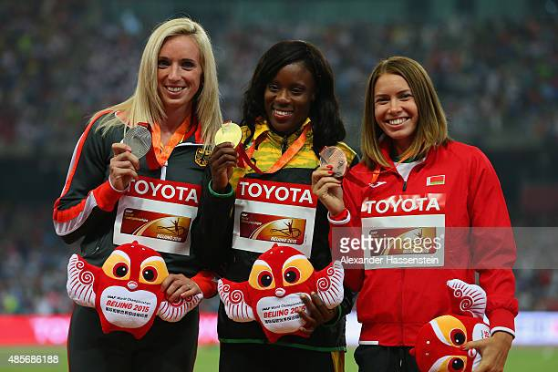 Silver medalist Cindy Roleder of Germany gold medalist Danielle Williams of Jamaica and bronze medalist Alina Talay of Belarus pose on the podium...