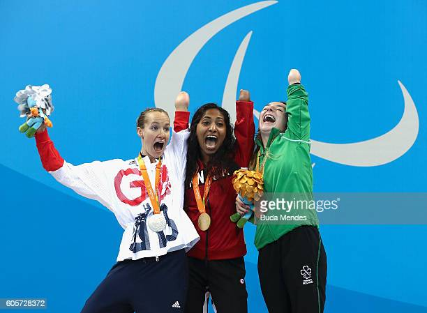 Silver medalist Claire Cashmore of Great Britain, gold medalist Katarina Roxon of Canada and bronze medalist Ellen Keane of Ireland celebrate on the...