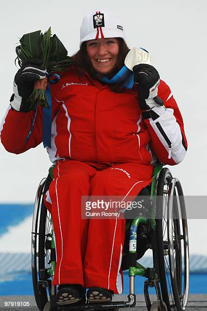 Silver medalist Claudia Loesch of Austria celebrates at the medal ceremony for the Women's Sitting Super Combined during Day 9 of the 2010 Vancouver...