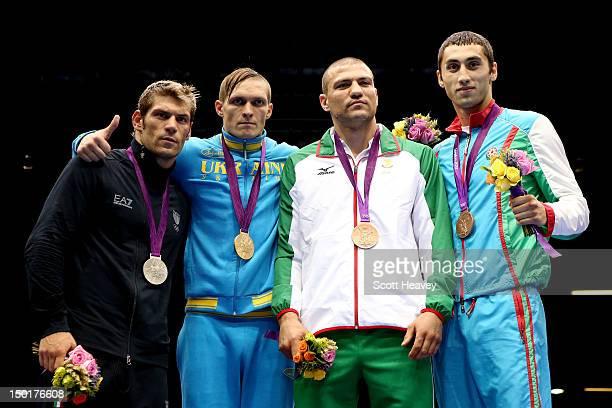 Silver medalist Clemente Russo of Italy gold medalist Oleksandr Gvozdyk of Ukraine bronze medalist Tervel Pulev of Bulgaria and bronze medalist...