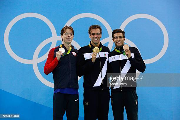 Silver medalist Connor Jaeger of the United States, Gold medalist Gregorio Paltrinieri of Italy and Gabriele Detti of Italy pose on the podium during...