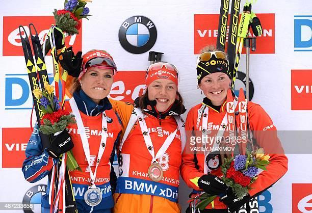 silver medalist Czech's Gabriela Soukalova Germany's gold medalist Laura Dahlmeier and France's bronze medalist Marie Dorin Habert pose on the podium...